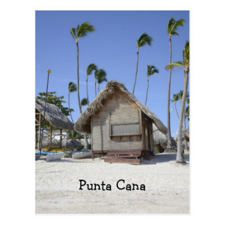 wood hut on a tropical beach postcard