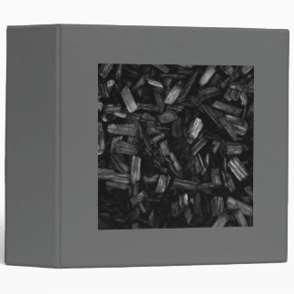Wood pieces in black and white. 3 ring binder