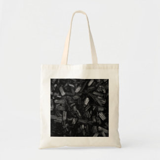 Wood pieces in black and white. bag
