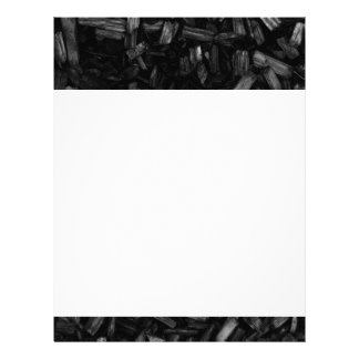 Wood pieces in black and white. letterhead