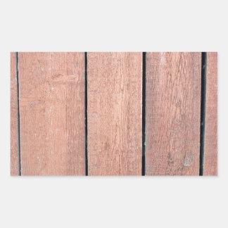 Wood planks closeup with peeling paint brown rectangular sticker