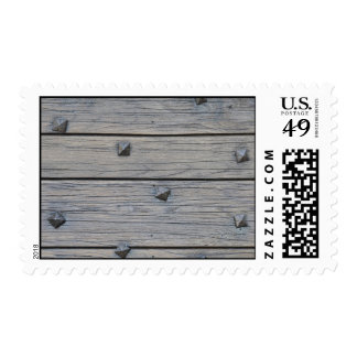 Wood planks with square nails texture postage stamp