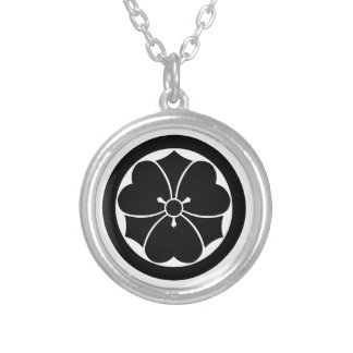 Wood sorrel with swords in circle round pendant necklace
