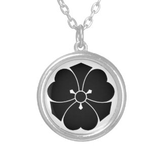 Wood sorrel with swords round pendant necklace