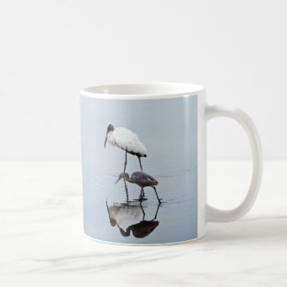 wood_stork_and_blue_heron_wading_coffee_