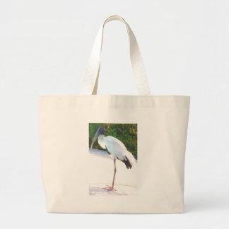 Wood stork in evening wear bag