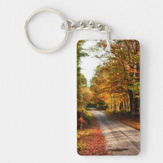 Wood trail with fall foliage Double-Sided rectangular acrylic keychain