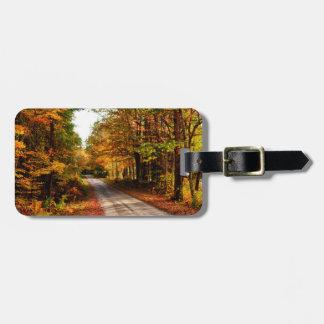 Wood trail with fall foliage luggage tags