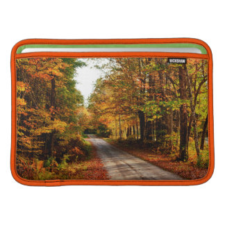 Wood trail with fall foliage MacBook sleeve