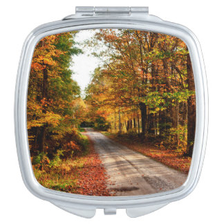 Wood trail with fall foliage mirror for makeup
