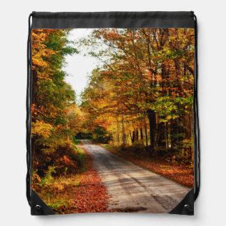 Wood trail with fall foliage drawstring bags