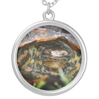 Wood turtle ornate head on in grass round pendant necklace
