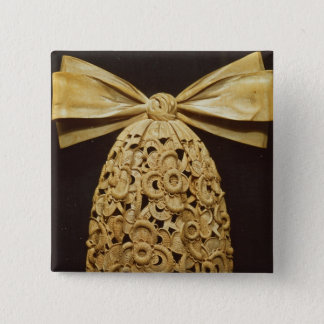 Woodcarving of a cravat pinback button