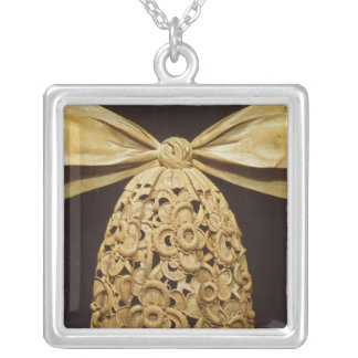 Woodcarving of a cravat silver plated necklace