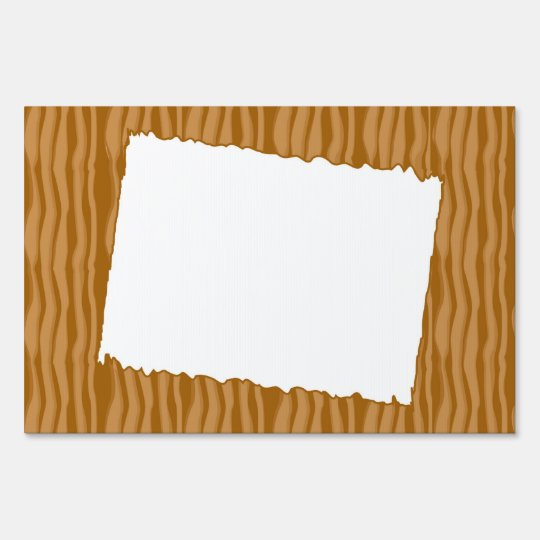 wooden background with white frame lawn sign