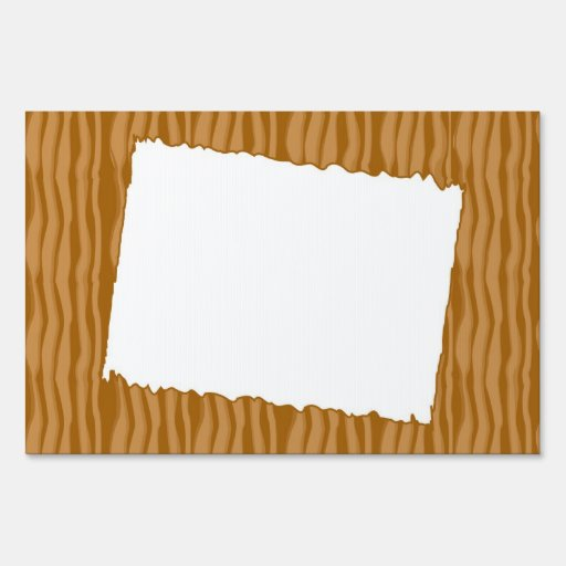 wooden background with white frame yard signs