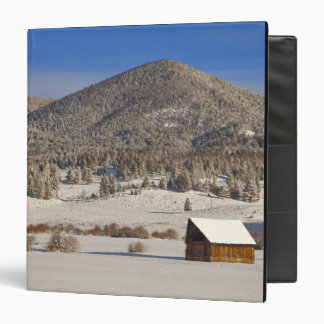 Wooden barn sits in snow near the Boulder Binder
