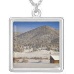 Wooden barn sits in snow near the Boulder Personalized Necklace