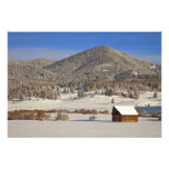 Wooden barn sits in snow near the Boulder Photograph