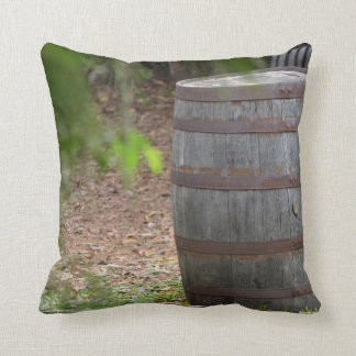wooden barrel right with green frond left throw pillow