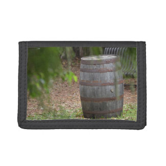 wooden barrel right with green frond left tri-fold wallet