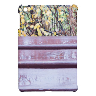 Wooden bench close-up with puddles after a rain iPad mini cover