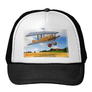 Wooden Biplane Over Farm Fields Trucker Hat