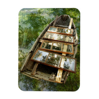 Wooden boat in a bed of rowan leaves magnet