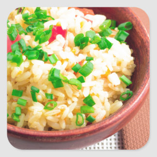 Wooden bowl of cooked rice and leek square sticker