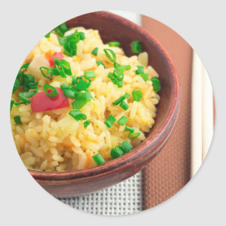 Wooden bowl of cooked rice and vegetables classic round sticker