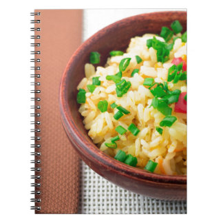 Wooden bowl of cooked rice and vegetables notebook
