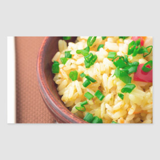 Wooden bowl of cooked rice and vegetables rectangular sticker