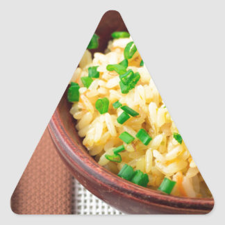 Wooden bowl of cooked rice and vegetables triangle sticker