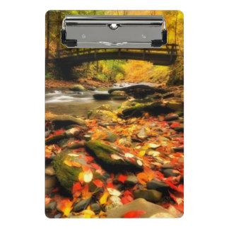 Wooden Bridge and Creek in Fall Mini Clipboard