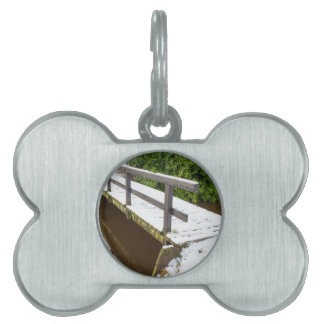 Wooden bridge covered with snow in winter pet tag
