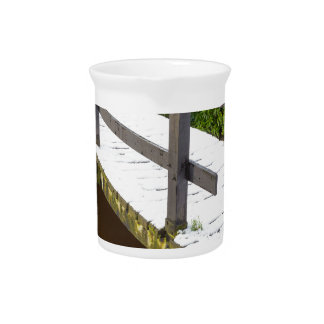Wooden bridge covered with snow in winter pitcher