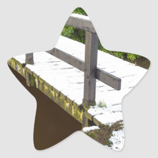 Wooden bridge covered with snow in winter star sticker