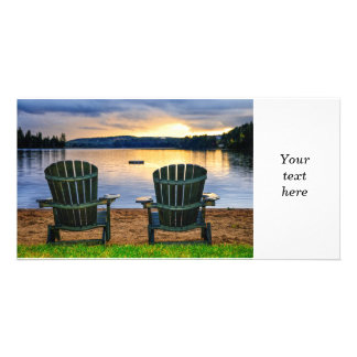 Wooden chairs at sunset on beach card