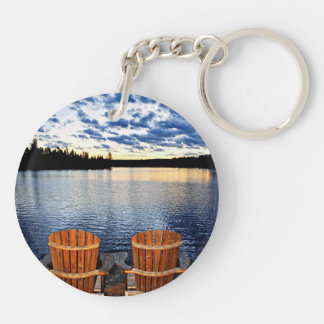 Wooden chairs at sunset on lake shore keychain