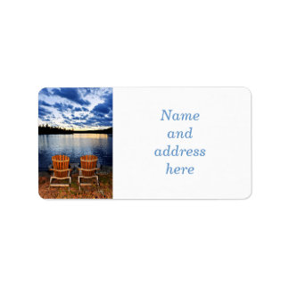 Wooden chairs at sunset on lake shore label
