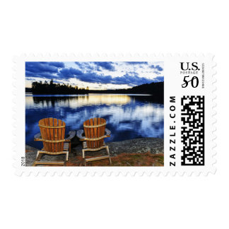 Wooden Chairs At Sunset On Lake Shore Postage