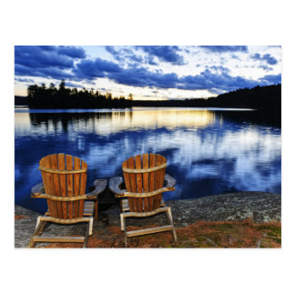 Wooden Chairs At Sunset On Lake Shore Postcard