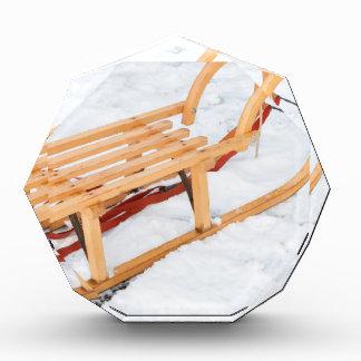 Wooden children sled in winter snow award