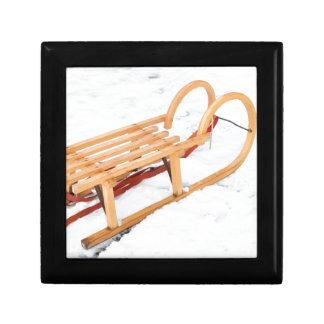 Wooden children sled in winter snow gift box