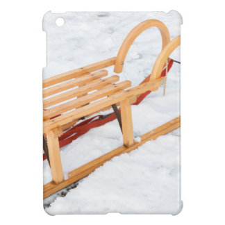Wooden children sled in winter snow iPad mini cover