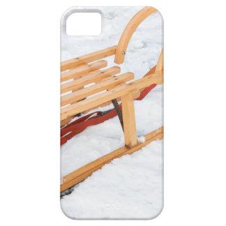 Wooden children sled in winter snow iPhone SE/5/5s case