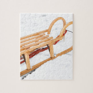 Wooden children sled in winter snow jigsaw puzzle