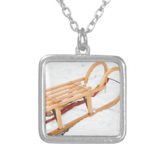 Wooden children sled in winter snow silver plated necklace