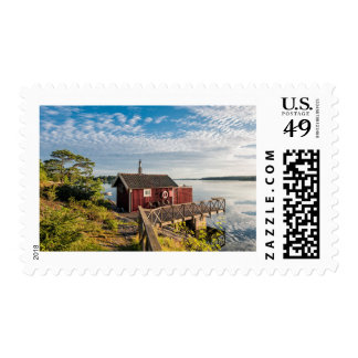 Wooden cottage on the Baltic Sea coast in Sweden Postage