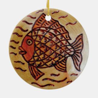 Wooden decor with fish. ceramic ornament